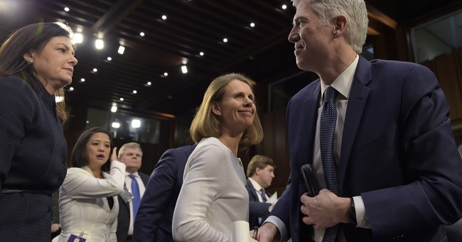 The Latest: Law professor: Gorsuch won't be 'robotic vote'